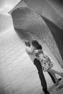 An engagement shot of this really great couple dancing at the walt disney concert hall in los angeles
