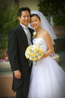 Bride and groom pose for a standard formal shot in Los Angeles