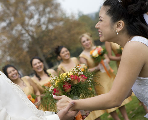 The bridesmaids in the background show their enthusiasm as the bride sees her groom for the first time. Sweet...